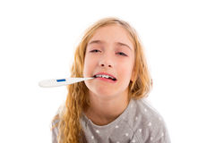 Blond girl with thermometer and flu cold in pyjama. And funny face Stock Photo