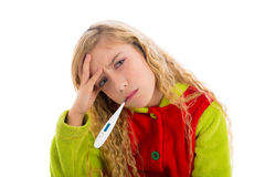 Blond girl with thermometer and flu cold in pyjama Royalty Free Stock Photo