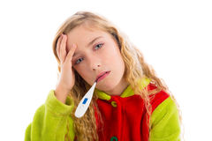 Blond girl with thermometer and flu cold in pyjama Stock Photography