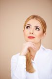 Blond girl thinking Royalty Free Stock Photography