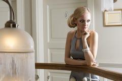 Blond girl thinking Stock Photos
