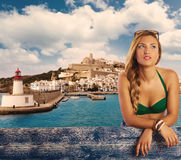 Blond girl tourist in Ibiza skyline summer top Royalty Free Stock Image