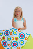 Blond girl with umbrella. Cute young blond girl with open umbrella; white studio background Stock Photography