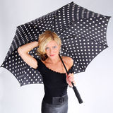 Blond girl with umbrella Royalty Free Stock Images