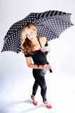 Blond girl with umbrella Stock Photo