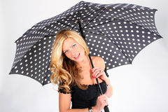 Blond girl with umbrella Royalty Free Stock Image