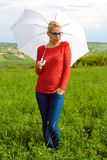 Blond Girl With Umbrella Stock Images
