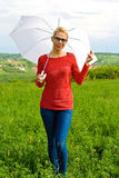 Blond Girl With Umbrella Stock Photos