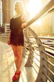 Blond girl under sun light stock photo