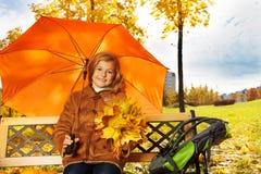 Blond girl under umbrella Royalty Free Stock Photography