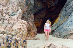 Blond girl walking on the beach in Spain Stock Images