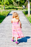 Blond girl walking Stock Photos