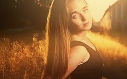 Blond girl in warm sunset light backlit, colorized image. Blond girl in warm sunset light backlit, colorized vintage toned shot image stock photography