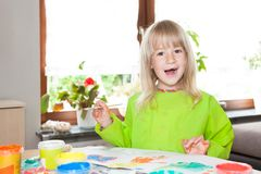 Blond Girl With Watercolors Royalty Free Stock Images