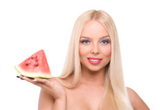 Blond girl with watermelon Stock Images