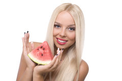 Blond girl with watermelon Royalty Free Stock Image