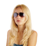 Blond girl wearing aviator sunglasses Royalty Free Stock Images