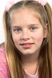 Blond girl wearing pink. Young girl in pink with long blond hair Stock Images