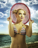 Blond girl wearing pink summer hat Stock Photos