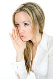 Blond girl whispering Stock Images