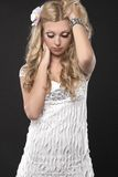 Blond girl in white clothing Stock Photography