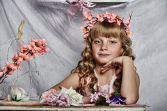 Blond girl with white flowers in her hair Stock Images