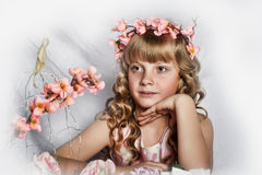Blond girl with white flowers in her hair Royalty Free Stock Images