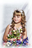 Blond girl with white flowers in her hair Royalty Free Stock Photos
