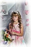 Blond girl with white flowers in her hair Royalty Free Stock Image