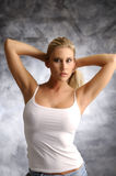 Blond girl in white shirt Stock Image