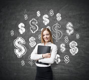Blond girl in white shirt and dollar signs Stock Photo