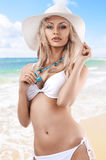 Blond girl with white summer hat Royalty Free Stock Images