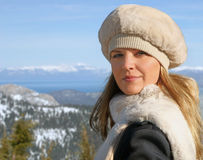 Blond girl in winter. Blond girl in a fur hat and a scarf Stock Images