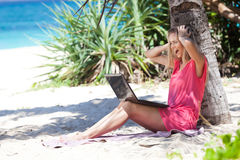 Blond Girl With A Laptop On Tropical Beach Stock Photos