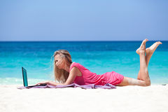 Blond Girl With A Laptop On Tropical Beach Royalty Free Stock Image