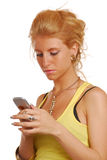 Blond girl writing sms Royalty Free Stock Photos