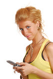 Blond girl writing sms Royalty Free Stock Image