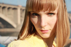 Blond girl in yellow blouse Royalty Free Stock Photos