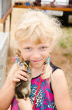 Blond girl with young duck stock photos