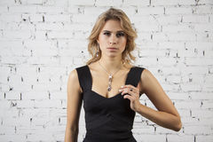 Blond glamour Girl in black party dress Stock Photos