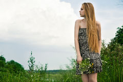 Blond in green grass Stock Photography