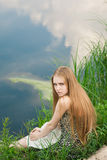 Blond in green grass Stock Photo