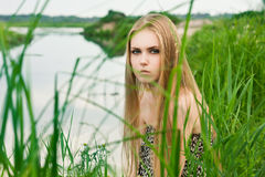 Blond in green grass Stock Image