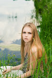 Blond in green grass Royalty Free Stock Photo