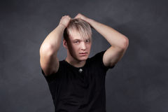 Blond guy with a gray background Royalty Free Stock Images