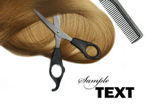 Blond Hair. Long healthy blond hair and professional scissors over white Royalty Free Stock Photography