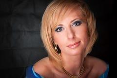 Blond Hair. Beautiful Blonde Girl. Beautiful Sexy Blonde Girl. Beauty  on a Black Background Stock Photo
