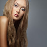 Blond hair. Beautiful woman with long hair Stock Photos