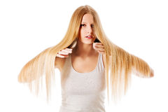 Blond hair. Beautiful woman with straight long hair. Blond hair. Beautiful woman with straight long hair Royalty Free Stock Photos