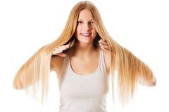 Blond hair. Beautiful woman with straight long hair. Blond hair. Beautiful woman with straight long hair Stock Photos
